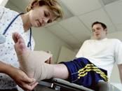 Photo : patient victime d'une entorse de la cheville